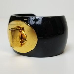 Coach Black and Gold Tone Turnlock Cuff Bracelet